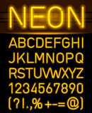 Neon font and symbols Royalty Free Stock Photo