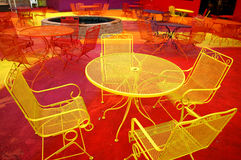 Neon furniture. Brightly painted outdoor furniture on the patio of a bar in Des Moines, Iowa Royalty Free Stock Images
