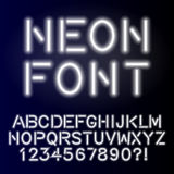 Neon glow alphabet custom handcrafted font. Font for design Royalty Free Stock Images