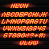 Neon glow font. Neon glowing Alphabet font and numbers on stripe background Stock Photo