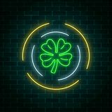 Neon glowing clover leaf sign in circle frames on a dark brick wall background. Green shamrock. As Irish national holiday symbol. Vector illustration stock illustration