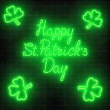 Neon glowing happy saint patricks day with clover leaves on a dark brick wall background. National Irish holiday symbol. Vector illustration Royalty Free Stock Photography