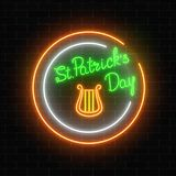 Neon glowing harp sign with lettering on a dark brick wall background. Green musical instrument as Irish national holiday symbol in circle frames. Vector Royalty Free Stock Photos