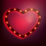 Neon glowing heart on red background. EPS 10 Royalty Free Stock Photo