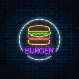 Neon glowing sign of burger in circle frame on a dark brick wall background. Fastfood light billboard symbol. Cafe menu item. Vector illustration royalty free illustration