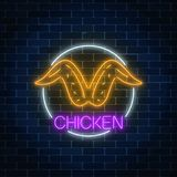 Neon glowing sign of chicken wings in circle frame on a dark brick wall background. Fastfood light billboard symbol. Cafe menu item. Vector illustration royalty free illustration