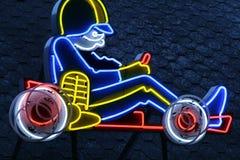 Neon Go Kart Sign. Neon sign of go kart on an outdoor building Stock Photo