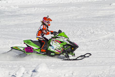 Neon Green Arctic Cat #223 Snowmobile Racing. EAGLE RIVER, WI - MARCH 2:  Neon Green Arctic Cat #223 Snowmobile Racing during a race on March 2, 2013 in Eagle Stock Image