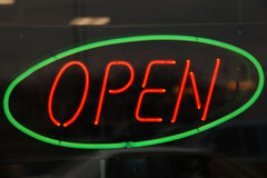 Neon Green Circle Open. Green circled neon Open Sign symbolizing readiness for business Stock Photos