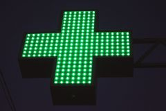 Neon green cross sign Stock Image
