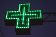 Neon green cross sign Royalty Free Stock Photography