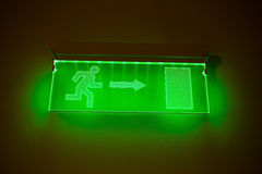 Neon Green Exit Sign set on black. Stock Photography