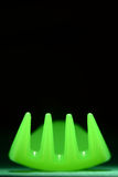 Neon Green Fork on Black Abstract. Bright neon green plastic fork tines abstract design on black Royalty Free Stock Image