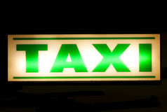 Neon green taxi sign Royalty Free Stock Photo