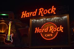 Neon Guitar Icon and Logo Hard Rock Café at Universal Studios CityWalk . Rock concept card. royalty free stock image