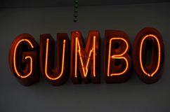 Neon Gumbo. A neon sign in a New Orleans restaurant window advertises the regional speciality gumbo soup stock images