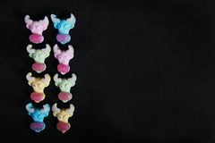 Neon gummy a cow candies on the black texture background Royalty Free Stock Images