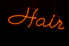Neon Hair Salon. Sign against black background Stock Images