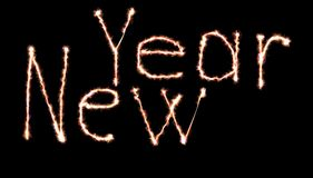 Neon Happy new year lettering written with fire flame or Royalty Free Stock Photography