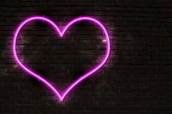 Neon Heart. Glowing Neon Heart on Old Brick Wall Royalty Free Stock Photos