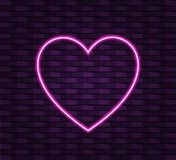 Neon heart on brick wall background, shining VECTOR frame template. Wall Dark Background Royalty Free Stock Images