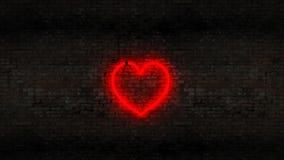 Neon heart on the brick wall Stock Photo