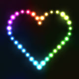 Neon heart in rainbow colors made from bulbs Stock Photography