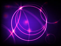 Neon Hoops. Pink neon hoops on black and blue background Stock Images