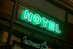 Neon Hotel Sign. Horizontal photo of a neon hotel sign. Internet sign is light too Stock Photos
