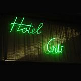 Neon hotel sign. A neon fluorescent hotel  sign on Royalty Free Stock Image
