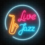 Neon jazz cafe with live music and saxophone glowing sign on a dark brick wall background. Glowing street signboard of bar with karaoke and blues singers Stock Photo