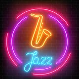 Neon jazz cafe with saxophone glowing sign with round frame on a dark brick wall background. Glowing street signboard of bar with karaoke and blues singers Royalty Free Stock Image