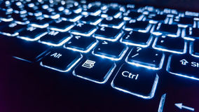 Neon keyboard with enter button. Focus on the  . Stock Photo