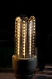 Neon lamp on display stand Royalty Free Stock Image