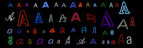 Neon letter A collection. Collection of a number of different neon letter A isolated on black - part of a series of neon letters Royalty Free Stock Image