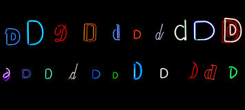 Neon letter D collection. Collection of a number of different neon letter D isolated on black - part of a series of neon letters Stock Images