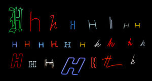 Neon letter H collection. Collection of a number of different neon letter H isolated on black - part of a series of neon letters Stock Photos