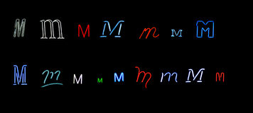 Neon letter M collection. Collection of a number of different neon letter M isolated on black - part of a series of neon letters Stock Photos