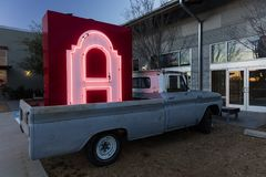 Neon Letter A sign in the backup of old pickup truck on Fort Worth Road, outside of Dallas. Car, White royalty free stock image