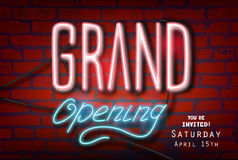 Neon lettering-GRAND OPENING-on a brick wall. Stock Photography