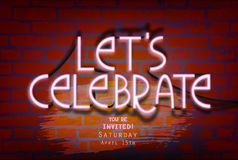 Neon lettering-Let`s celebrate-on a brick wall. Stock Image