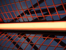 Neon light. Abstract red neon light and red fence royalty free stock photo
