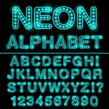 Neon light alphabet in cyan color. Glowing font for design. Neon sign. Royalty Free Stock Photo