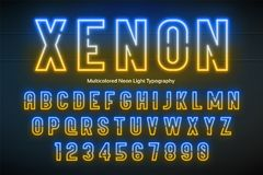 Neon light alphabet, multicolored extra glowing font Royalty Free Stock Image