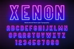 Neon light alphabet, multicolored extra glowing font Royalty Free Stock Photo