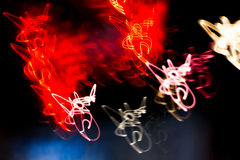 Neon light blurr I. Red, white and pink neon light with blurr effect and black background Stock Photography