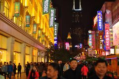 Neon light night view of the famous Nanjing Road in Shanghai China. royalty free stock photo