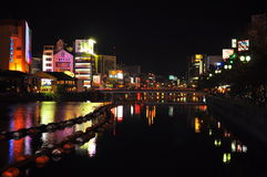 Neon light reflection. Night view of Fukuoka Japan at the Hakata river which run along Nakasu area that contain the red light district of Fukuoka Royalty Free Stock Image