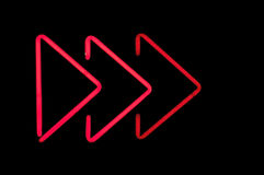 Neon light pointer red. Sign backgrounds communication electronics red rot signal mark token shape arrow head arrow light Stock Image