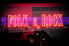 Neon lighted shop window of music store with rock & folk music in Malmo in Sweden Stock Photos